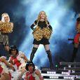 Madonna, entourée par Nicki Minaj et M.I.A., lors du  halftime show  du Super Bowl, à Indianapolis, le 5 février 2012