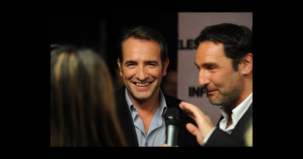 Jean dujardin et gilles lellouche le 14 f vrier 2012 lors for Dujardin et lellouche
