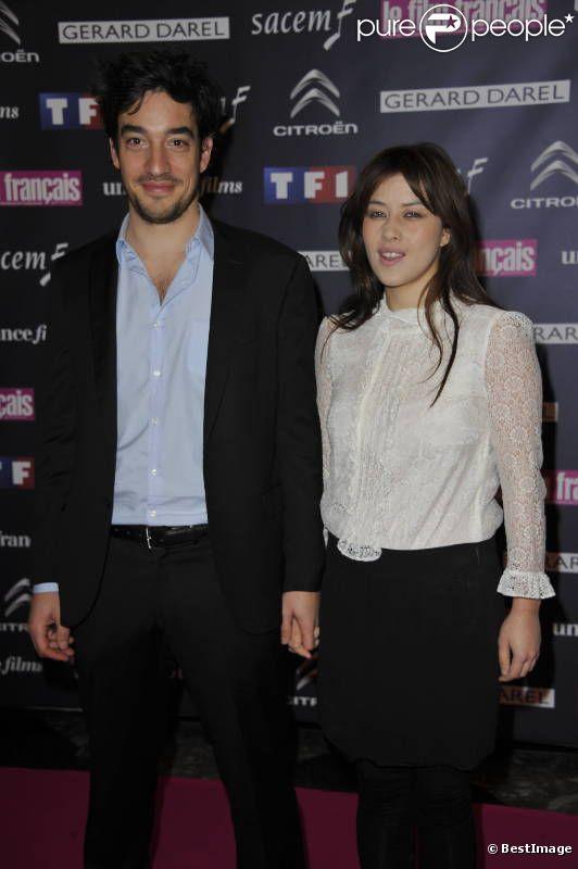 Mylène Jampanoï et son compagnon Dimitri Stephanides lors des 19ème Trophées du film français, à Paris, le 14 février 2012