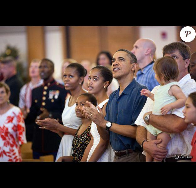 Barack Obama et sa fille Malia, 13 ans, en décembre 2011 à Hawaï.