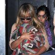Radieuse, Beyoncé porte sa fille Blue Ivy à New York le 12 avril 2012