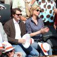 Michèle Laroque et son compagnon François Baroin dans les tribunes de Roland-Garros, le 2 juin 2012.