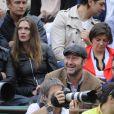 Calogero et sa compagne Marie, Kad Merad et Manu Payet lors de la finale de Roland-Garros entre Rafael Nadal et Novak Djokovic le 10 juin 2012 à Paris
