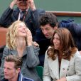 Patrick Bruel, Sandrine Kiberlain et Laurence, la compagne de Manu Katché lors de la finale entre Rafael Nadal et Novak Djokovic à Roland-Garros le 10 juin 2012