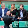 Patrick Poivre d'Arvor, Lilou Fogli et Clovis Cornillac lors de la finale entre Rafael Nadal et Novak Djokovic à Roland-Garros le 10 juin 2012