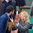 Manu Payet et Sandrine Kiberlain lors de la finale entre Rafael Nadal et Novak Djokovic à Roland-Garros le 10 juin 2012