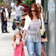 Alyson Hannigan et sa fille Satyana font du shopping à Los Angeles, le samedi 14 juillet 2012.