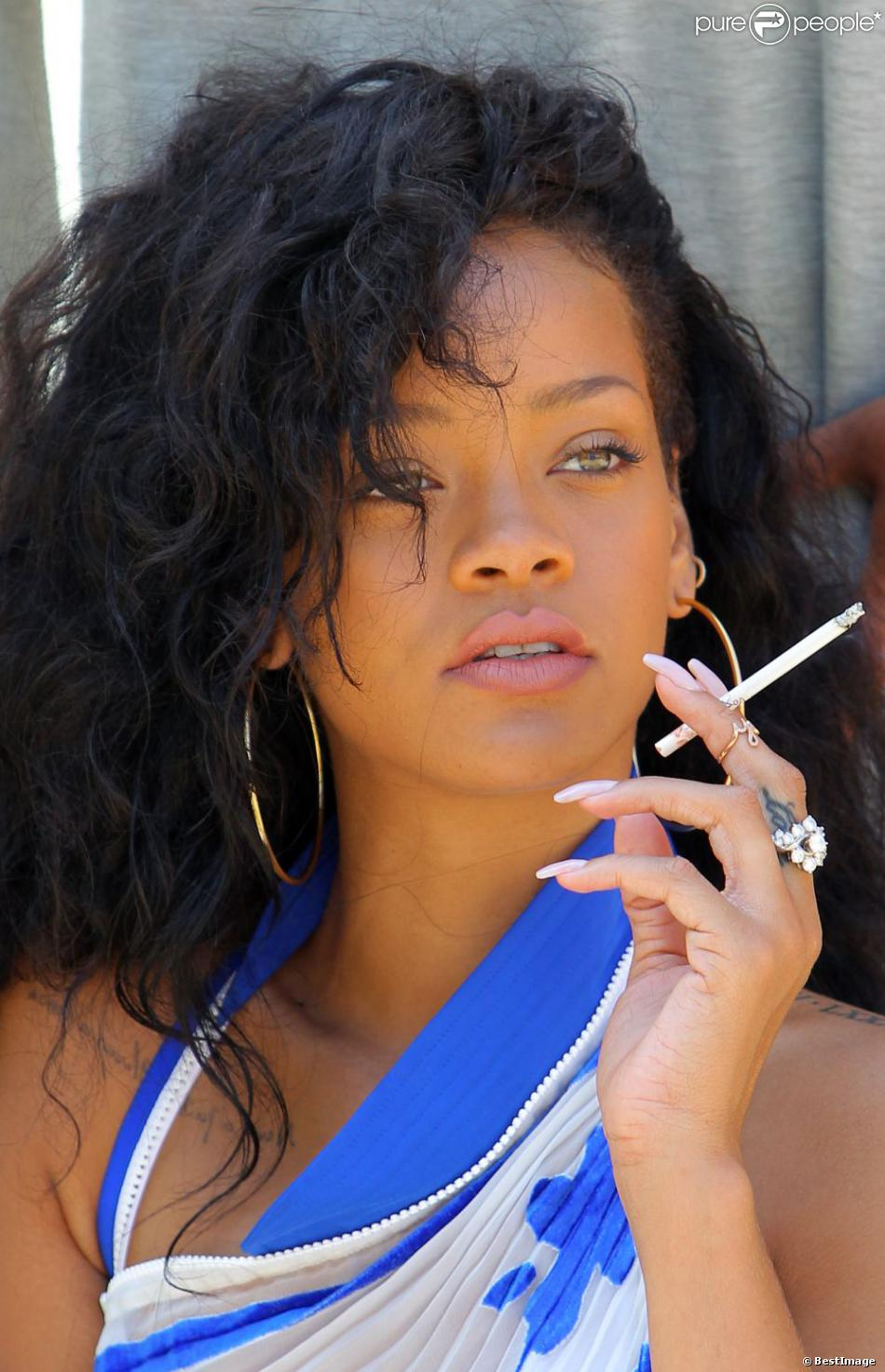 Rihanna smoking a cigarette (or weed)
