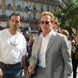 Arnold Schwarzenegger, son fils Patrick et sa fille Katherine vont déjeuner au Jules Verne à Paris le 10 août 2012