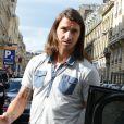 Zlatan Ibrahimovic, cheveux au vent, s'est offert un déjeuner en compagnie d'un ami au restaurant L'Avenue à Paris le 19 septembre 2012