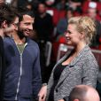 Virginie Efira enceinte et son compagnon Mabrouk El Mechri échangent avec Pierre Niney lors du 16e festival international du film de comédie de l'Alpe d'Huez, le 19 janvier 2013.