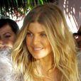 Fergie quitte avec le sourire le restaurant Ivy at the Shore à Santa Monica. Le 2 mars 2013.