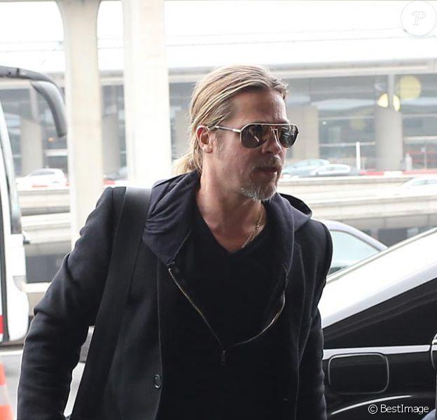 Exclu : Brad Pitt à Roissy dimanche 10 mars 2013, prend l'avion pour Los Angeles.