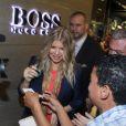 Fergie enceinte a assité à l'inauguration d'une boutique Hugo Boss à Rio de Janeiro, le 3 avril 2013.