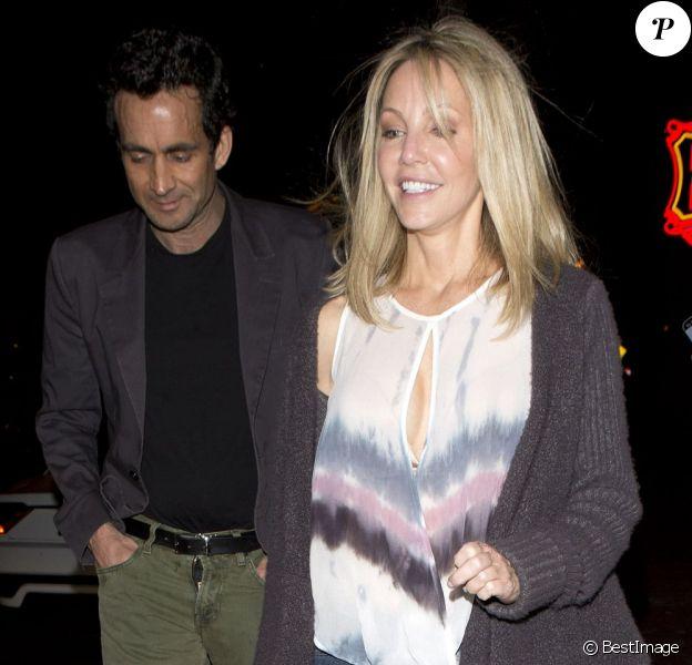 Heather Locklear est allée dîner au restaurant RivaBella avec un mystérieux inconnu qui avait oublié de fermer sa braguette en sortant. West Hollywood, le 16 avril 2013.