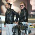 Johnny et Laeticia Hallyday en France. Le couple a pris le même avion que Bob Sinclar. Paris, le 21 mai 2013.