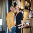 Paul et Luana Belmondo lors de l'exposition Ecris-moi des mots d'Amour, par Alejandra di Andia, photos de Ian Abela, à la boutique Montblanc, le 4 juin 2013.