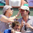 Valerie Benguigui et Lionel Abelanski lors du onzième jour des Internationaux de France à Roland-Garros, le 5 juin 2013