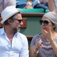 Valérie Benguigui et son époux lors du onzième jour des Internationaux de France à Roland-Garros, le 5 juin 2013
