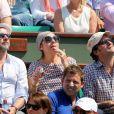Valérie Benguigui, son époux et Lionel Abelanski lors du onzième jour des Internationaux de France à Roland-Garros, le 5 juin 2013