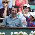 Marina Foïs, Eric Lartigau et leurs enfants lors du onzième jour des Internationaux de France à Roland-Garros le 5 juin 2013