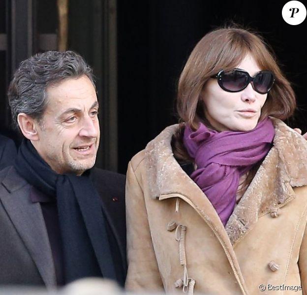 Nicolas Sarkozy et Carla Bruni-Sarkozy à la sortie du Royal Monceau, à Paris, le 9 février 2013.