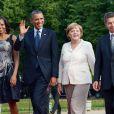 Michelle Obama, Barack Obama, Angela Merkel et son mari Joachim Sauer prennent la pose ensemble avant le dîner officiel organisé au palace Charlottenburg à Berlin, le 19 juin 2013.