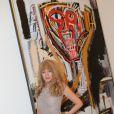 """Arielle Dombasle devant un Basquiat - Vernissage de l'exposition """"Les aventures de la vérité - Peinture et philosophie : un récit"""" conçue par BHL à la Fondation Maeght à Saint-Paul-de-Vence, le 28 juin 2013."""