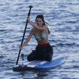 Kendall Jenner et son frère Brody Jenner font du surf, à Malibu, pour les besoins de la télé réalité Keeping Up With The Kardashians, le 8 juillet 2013.