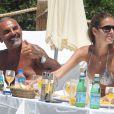Christian Audigier et sa fiancée Nathalie Sorensen à Ibiza, le 8 juillet 2013.