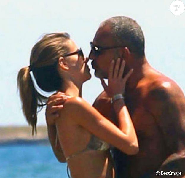 Christian Audigier et sa fiancée Nathalie Sorensen en vacances à Ibiza, le 8 juillet 2013.