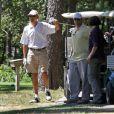 Barack Obama s'offre une partie de golf sur le Farm Neck Golf Club de Oak Bluffs, le 11 août 2013 pour débuter ses vacances