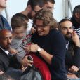 Jean Sarkozy et son fils lors de la rencontre de Ligue 1 entre le PSG et Guingamp (2-0), au Parc des Princes, le 31 août 2013.