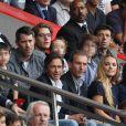 Jean Sarkozy et son fils Solal au milieu de nombreuses familles (Jalil Lespert et son fils à gauche, Patrick Bruel et ses deux garçons au fond à droite, et Raymond Domenech avec son fils en bas) lors de la rencontre de Ligue 1 entre le PSG et Guingamp (2-0), au Parc des Princes, le 31 août 2013.