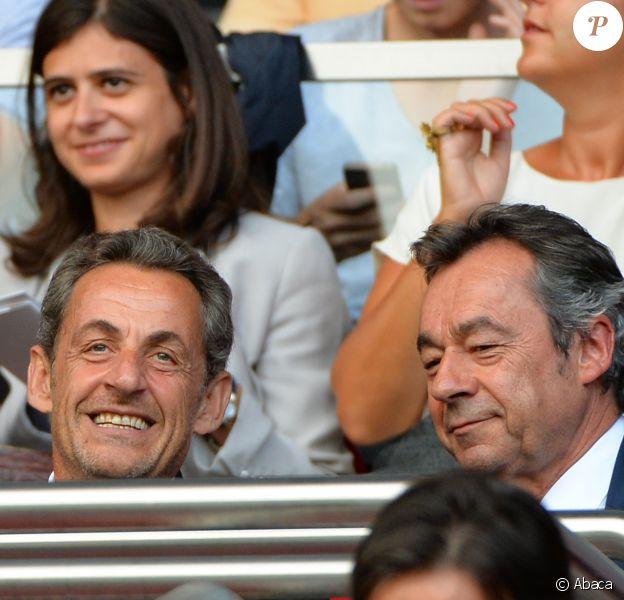 Nicolas Sarkozy et Michel Denisot complices lors de la rencontre de Ligue 1 entre le PSG et Guingamp (2-0), au Parc des Princes, le 31 août 2013.