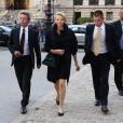 La princesse Charlene de Monaco, accompagnée de ses gardes du corps et de Peter Kriemler, PDG d'Akris, arrive à la galerie sud est du Grand Palais pour assister au défilé printemps-été 2014 de la griffe suisse. Paris, le 29 septembre 2013.