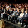 Quentin Tarantino, Claudia Cardinale, Luana et Paul Belmondo, Jean-Paul Belmondo, Gérard Collomb, Mélanie Thierry enceinte lors de la soirée d'ouverture du Festival Lumière à Lyon et l'hommage à Jean-Paul Belmondo au sein de la Halle Tony Garnier, le 14 octobre 2013