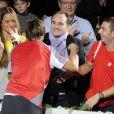 """""""David Ferrer embrassant son coach sous l'oeil de sa compagne Marta Tornel lors de son triomphe au Masters de Bercy le 4 novembre 2012"""""""