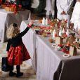 La craquante Ashtyn Gardner, 2 ans, assiste à la présentation des décorations de Noël de la Maison Blanche. Washington, le 4 décembre 2013.