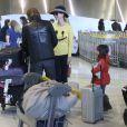 Johnny Hallyday et Laeticia arrivent à l'aéroport de Paris en provenance de Los Angeles. Le couple est accompagné de ses filles, Jade et Joy, de la grand-mère de Laeticia, Eliette, du chien du rockeur, Santos, et des musiciens de Johnny. Le 8 décembre 2013.
