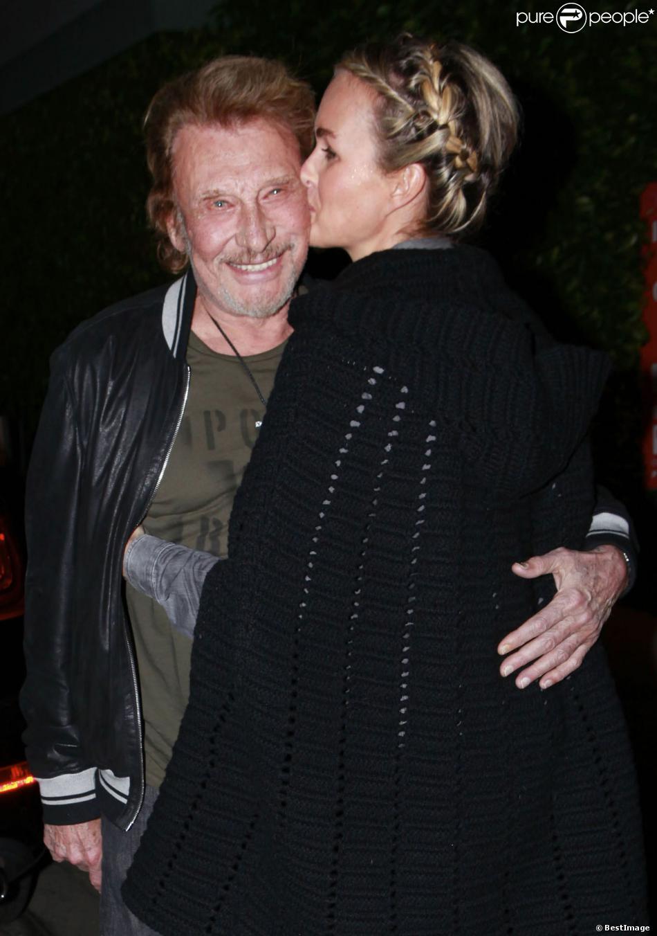 Johnny Hallyday et sa femme Laeticia au restaurent Giorgio Baldi à Los Angeles, le 1er décembre 2013.