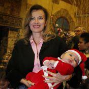 Valérie Trierweiler : La Mère Noël, bébé dans les bras, distribue ses cadeaux