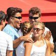 Exclusif - Igor et Grichka Bogdanoff posent avec des jumelles dans les rues de Saint-Tropez le 24 août 2013.