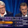 Christophe Dechavanne et Patrice Carmouze dans Qui veut gagner des millions? sur TF1 le vendredi 14 février 2014