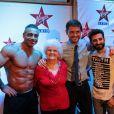 Christophe Beaugrand, Lucienne et Kheiron posent avec un strip-teaser dans les locaux de Virgin radio, mercredi 19 février 2014.