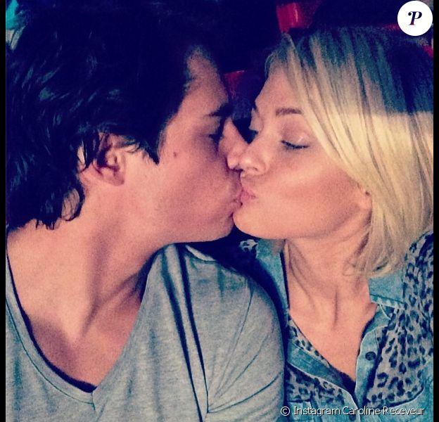 Caroline Receveur et Valentin s'embrassent durant le concert d'Avicii à Paris, le 14 février 2014