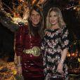 Anna Dello Russo et Hofit Golan assistent au défilé Dolce & Gabbana automne-hiver 2014-15 à Milan. Le 23 février 2014.