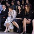 Le premier rang du défilé défilé Dolce & Gabbana automne-hiver 2014-15, avec Bianca Balti, David Gandy, Kate King, Monica Bellucci, Bianca Brandolini d'Adda et Eva Herzigova. Milan, le 23 février 2014.