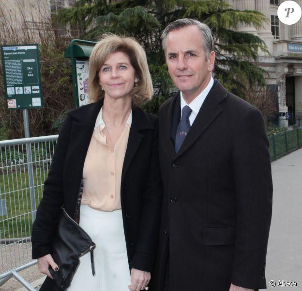 Anne et Bernard de la Villardièrearrivent au Grand Palais pour assister au défilé Chloé. Paris, le 2 mars 2014.