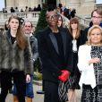 Le footballeur Djibril Cissé arrive au Grand Palais pour assister au défilé Chloé. Paris, le 2 mars 2014.